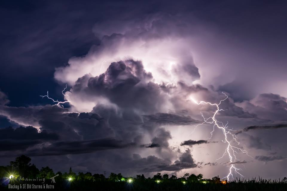 A massive clear air bolt lets rip out the side of an exploding thunderstorm just after sunset off the coast of Mackay Australia back on the 20th January 2015.