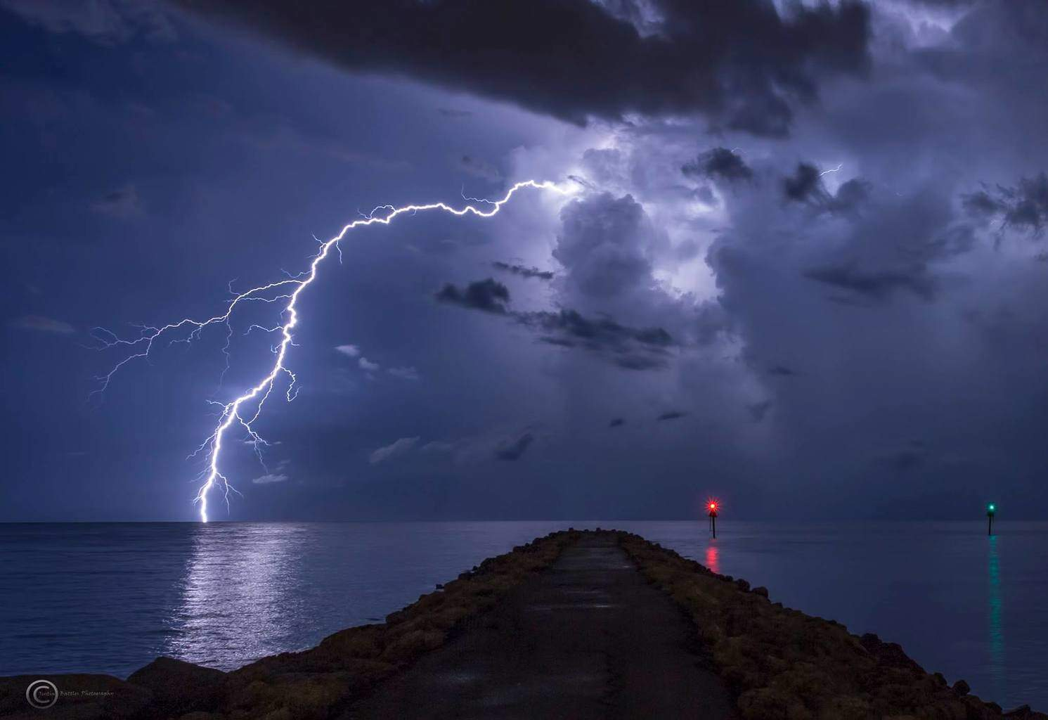 This storm spit out some awesome bolts at the South Jetty in Venice, Fl 7-10-15