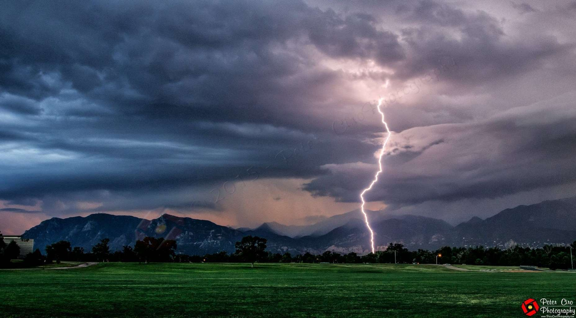 Lightning strike in Colorado Springs with Pikes Peak in the background. The severe thunderstorm coming over the mountains started to weaken and we got just sprinkles. — at Memorial Park.