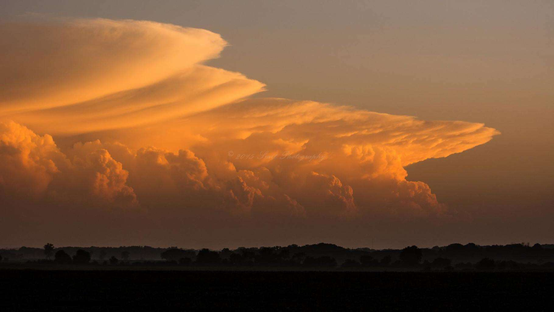 Fading sun lights anvils spreading out of from powerful cells in a system hitting Northern Illinois 7/13/15