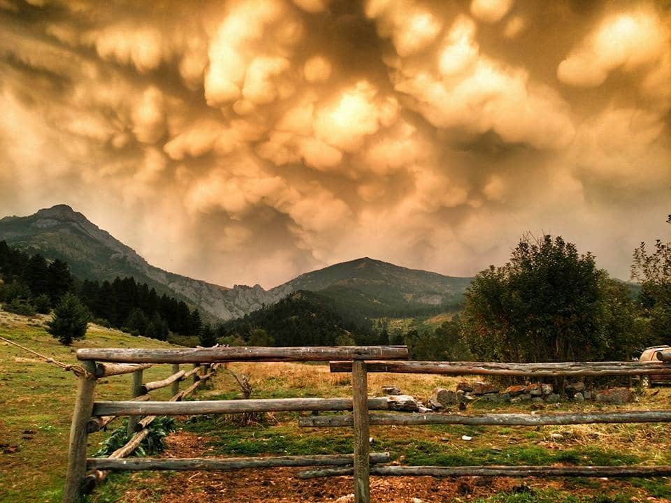 Mammatus clouds following a storm this evening over the Bridger Mountains, North of Bozeman, MT. They are Orange due to all the Smoke in the air from forest fires.
