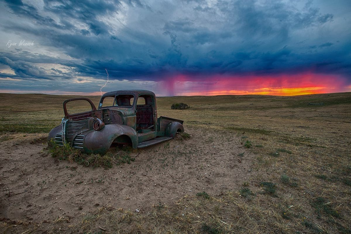 Less than 24 hours after getting permission to go into this cattle pasture along the river in Saskatchewan, I drove out to photograph the sunset. Then the lighting started, so I took a series of 1 second exposures and got lucky.