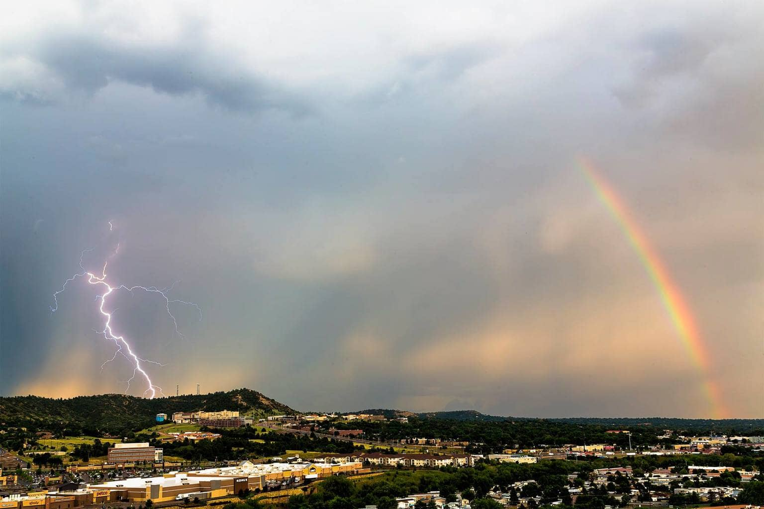 A lightning bolt and rainbow sharing the sky in Colorado Springs. 08/27/2015