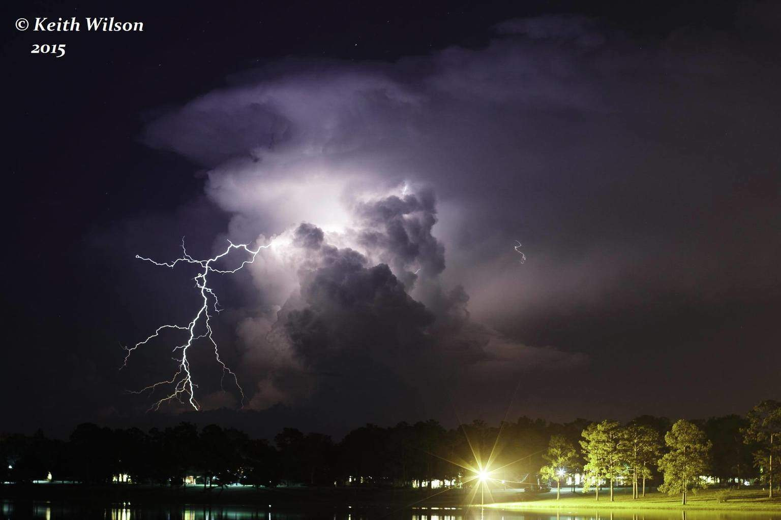 Florida Panhandle on 8/9/15. One of days where you aren't expecting any action, then darkness falls and you see flashes through the trees. Went to this spot about a mile from my house and was treated to this bolt producing isolated beast.
