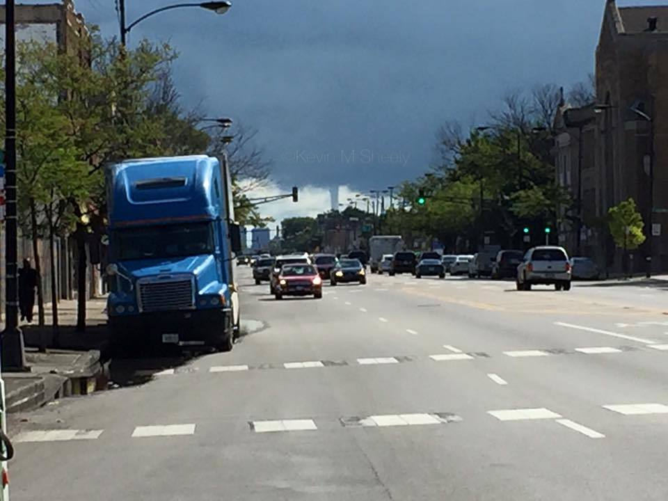 Waterspout viewed from North ave and Laramie in Chicago. I was 7 miles from Lake Michigan when I just happened to walk around the front of my truck and see this looking east on North Avenue!