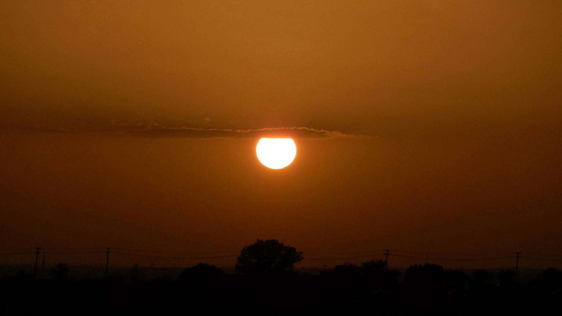 The sun hanging off a cloud. Photo was taken August, 2014 Texas