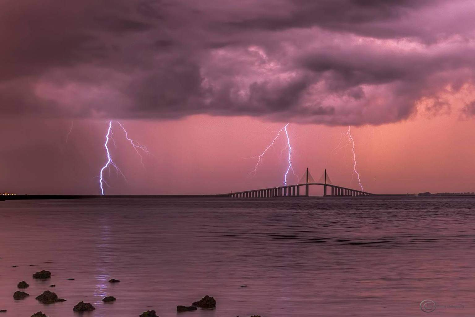 The Sunshine Skyway Bridge in St Petersburg, Fl getting pounded by lightning around sunset this evening