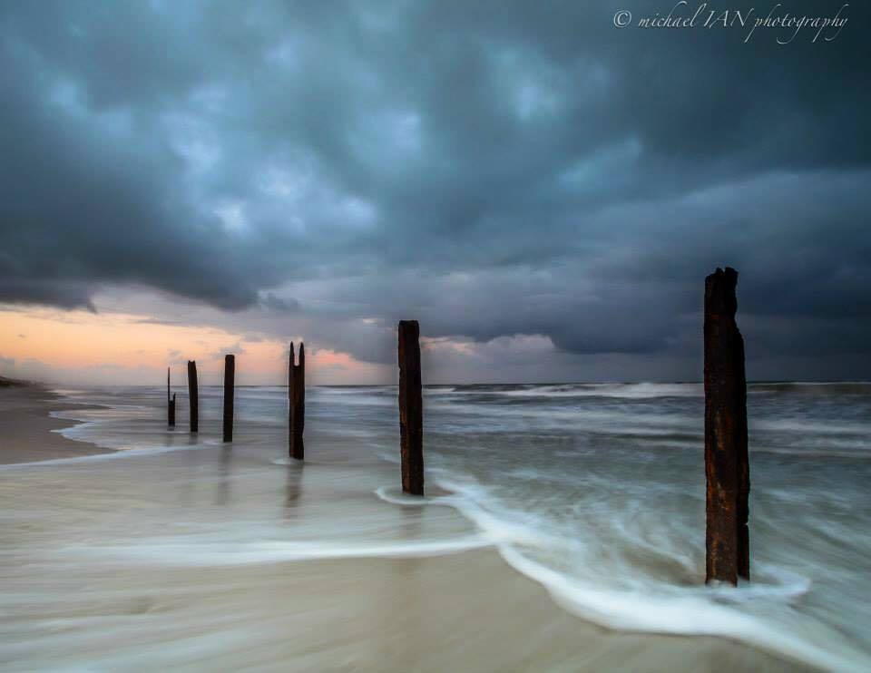 Big storm off the coast of Marineland Florida. These pillars use to hold up a piece of Marinland Oceanarium which was the first one of its kind.