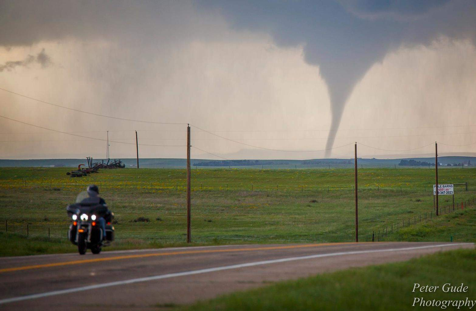 This was taken on US 24 in between Simla and Limon. I wonder if the biker checked his mirror to see this nice tornado, or he was wondering what everybody was looking at, or just heading for a stop in Limon...