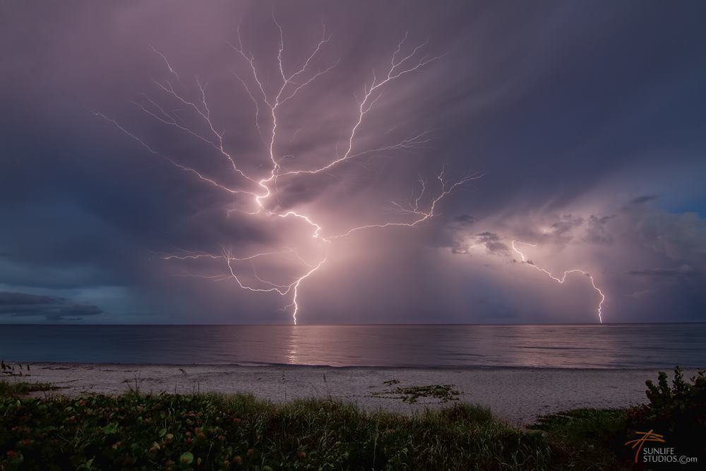 Storm this evening during sunset in Juno Beach Florida. Canon 7D + 11-16 f2.8 Tokina 2 images stacked F8 15 seconds iso 320.