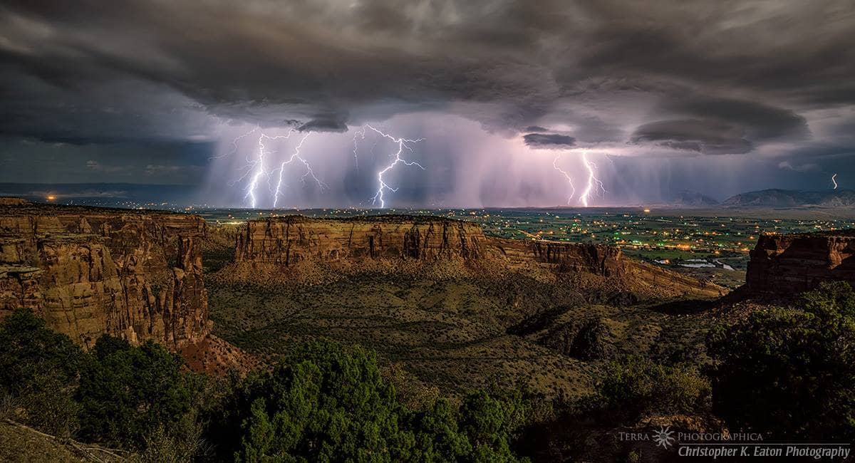 As I started heading east to intercept a line of storms sweeping in from the northwest towards Glenwood Springs and De Beque, Colorado, a new set of thunderstorms popped up to the west heading for Fruita and Colorado National Monument. A quick course correction and I was soon in position as these storms became electric. Here, two thunderstorms drop lightning over Fruita, Colorado with Monument Canyon illuminated by the near full moon in the foreground; a solitary bolt strikes the Book Cliffs in the distance from the other set of storms.