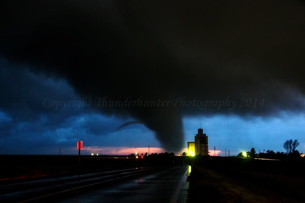 Lightning illuminates a menacing tornado with horizontal vortex during a night intercept near Page City, Kansas on June 5 2015. We encountered 8 tornadoes in the hook on this night.