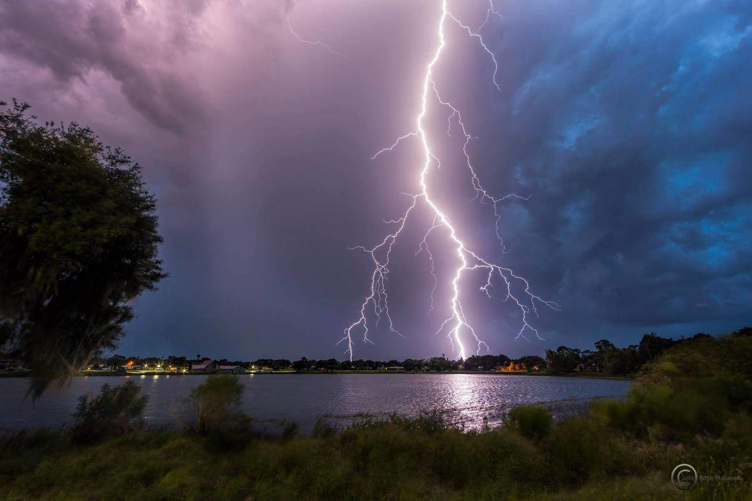 Pretty close strike at Lake Lillian in Avon Park, Florida yesterday around sunset as this storm fired up.14mm full frame, not cropped