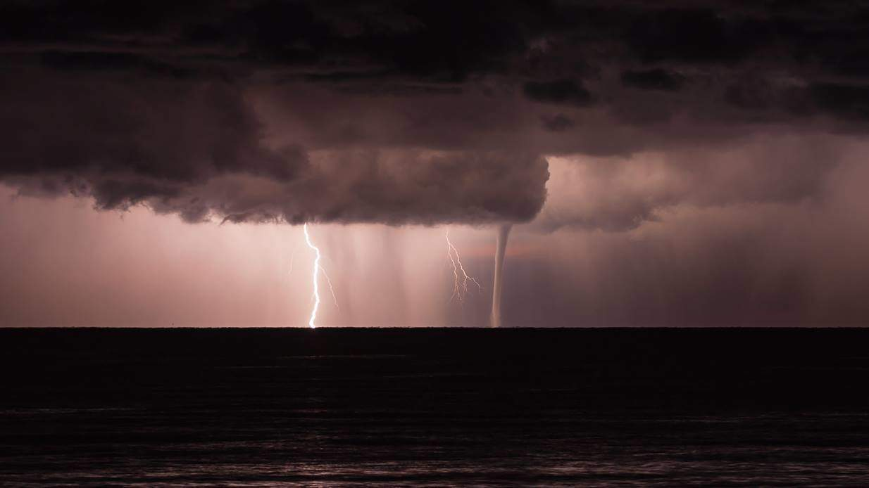 My lucky shot of this nighttime waterspout i photographed in december of 2012 near the shore of south Istria, Croatia.. The lightning helped me in catch this beautiful moment and i managed to take a few more shots before it disappeared.