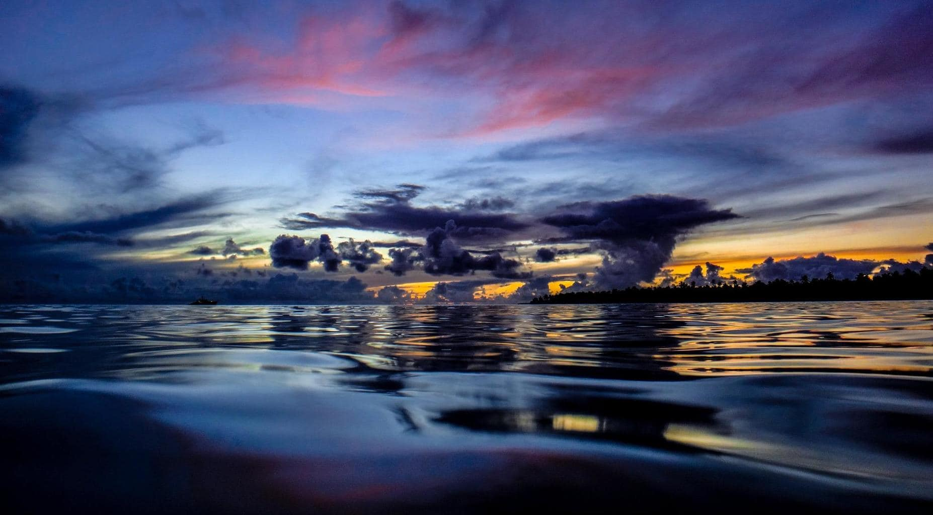 Another beautiful sunset enjoyed from the water on Direction Island, Cocos (Keeling) Islands, Indian Ocean.
