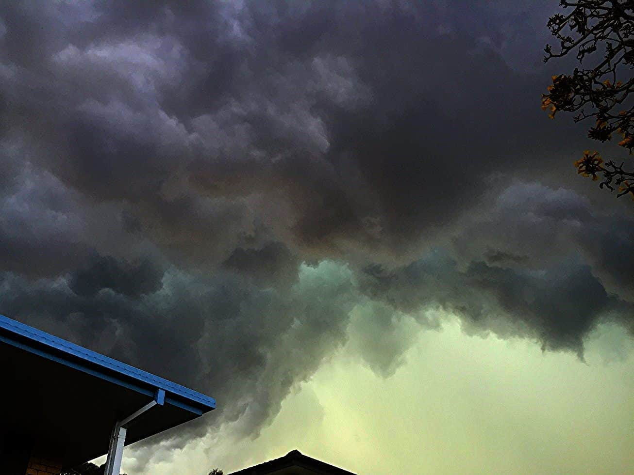 Greenage under the base of a shelf cloud of an approaching thunderstorm. Brisbane, Australia - Sep 29th 2015: