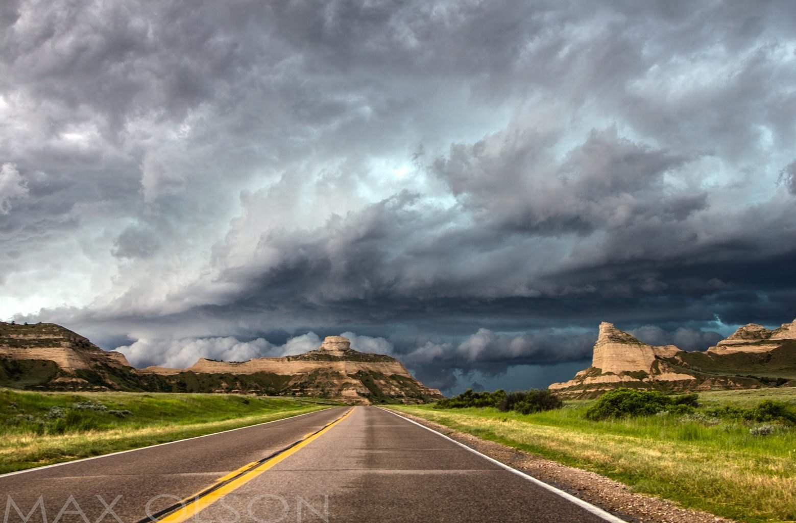 Big hailer rolling over the bluffs and into town, earlier on this storm did substantial damage to crops and homes in Torrington, WY .  June 16, 2015 Scottsbluff, NE
