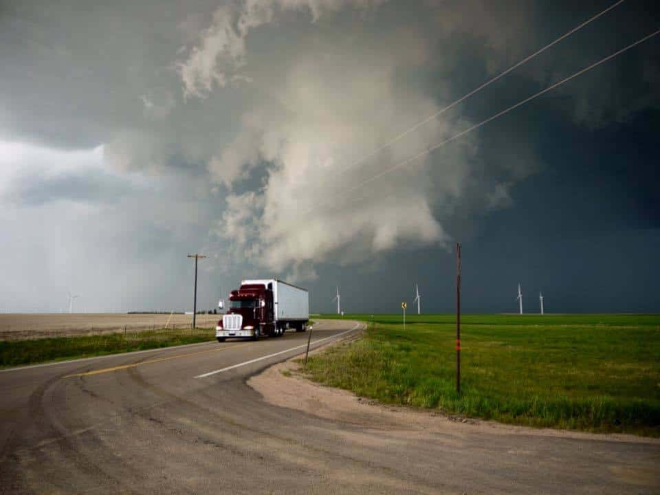 A rotating cloud crossing the road while the truck was in a hurry to get out of its way. June, 2014. Colorado.