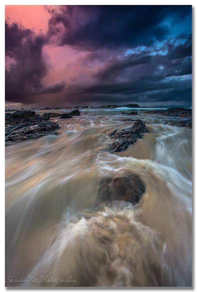 This was shot at Currumbin last summer where in the space of half an hour, the weather went from clear skies, to a storm that looked nasty, and then back to clear skies!! I got shots of all and they look like completely different days!! Was really cool.
