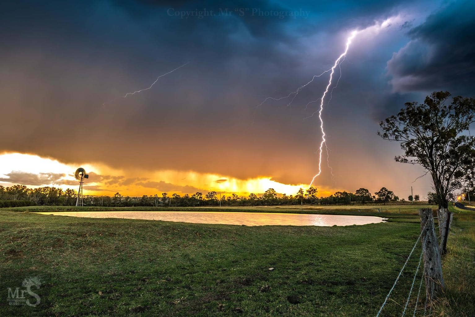 !!! The Perfect Sunset For A Storm Chaser !!! Well today was the day. At Sunset I raced to a popular spot at Willowbank Qld in Australia in the hope of my dream shot I had imagined since last season. And to my excitement it came true. The fact this is captured with a wide angle doesn't show that the bolt only struck around 800 meters away. I am so so very happy