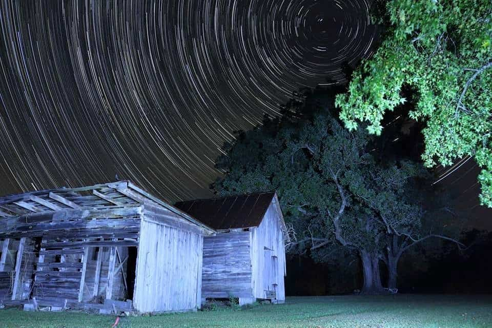 Every star in the Northern Hemisphere rotates around Polaris (North Star). Long exposure night photography can give you stunning photos, like these star trails I took this morning.  126 photos taken, and images stacked. ISO 100 F/4 30 sec shutter speed 15~55 mm lens at 18mm on a Canon T5i. (Crop senor, not really 18mm.) I light painted the first photo with a flashlight to brighten the fore ground, over did it a little, will stand further away next time.