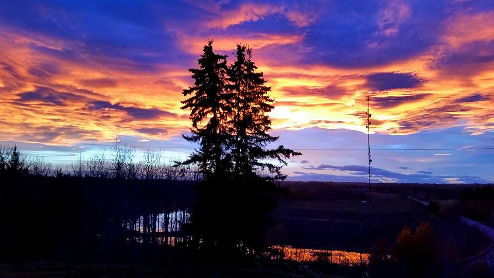 Breathtaking sunset in Red Deer, Alberta. Nothing quite like Albertan skies! I love the reflection on the water at the bottom of the hill. I'm blessed to have this as the view from my living room. Taken on my cell phone tonight. ? October 9th, 2015