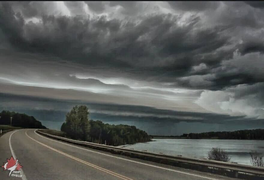 """""""The Road Less Travelled"""" - Shelf cloud rolling over a pond near Warburg, Alberta in July '15."""