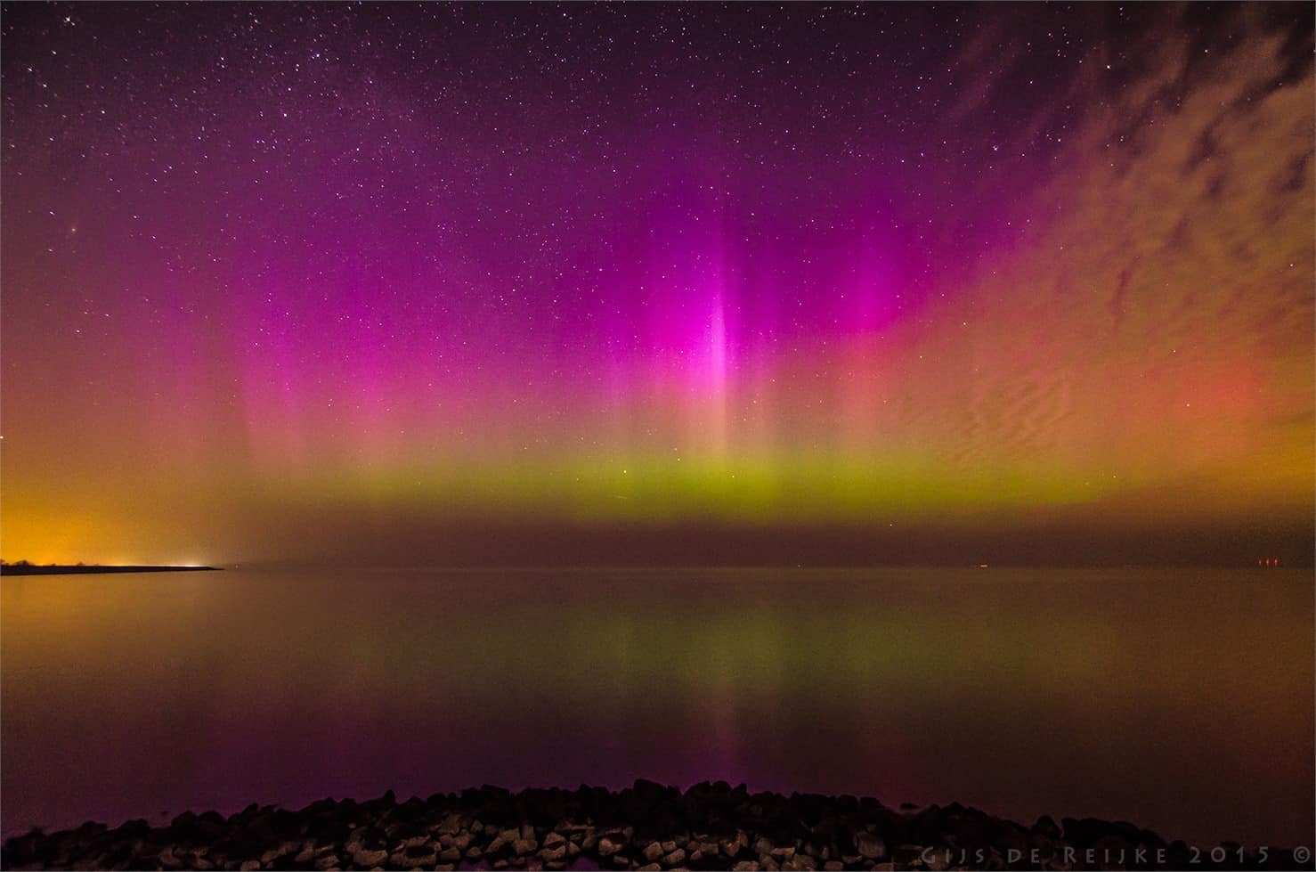 Since the Aurora Borealis pics are doing well here, I'll post another one of mine, shot in the Netherlands on March 17 of this year wink emoticon . This was the first one I actually saw with the naked eye. On average we get to see the Northern Lights this bright maybe about once per decade 'down here', so I was glad I was able to capture them. Due to cloud cover we missed the other large events of 2015.  Picture shot on the Houtribdijk between Lelystad and Enkhuizen, with a Nikon D7000 and Tokina 11-16mm f2.8 DX II, at 11mm, ISO800, 15 sec. and f2.8.