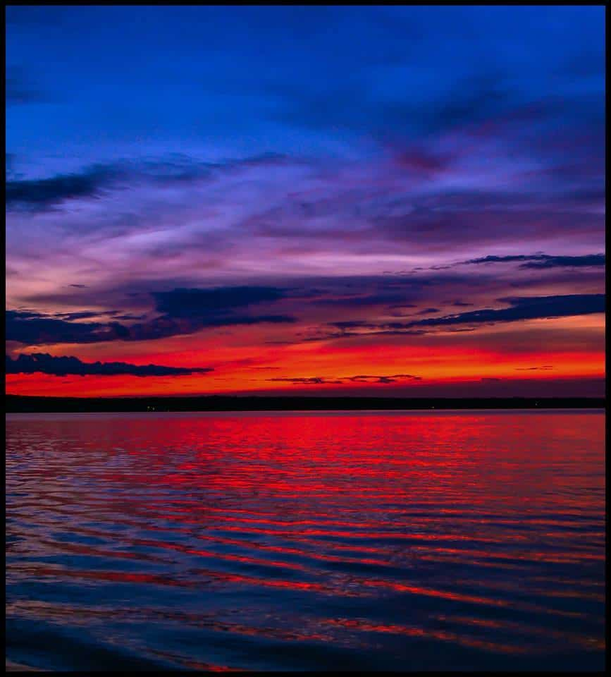 This is probably one of my favorite sunset images ever. This was taken at Higgins Lake, MI I believe last year. The colors were so vibrant that this picture doesn't even do it justice. You cant beat a calm lake and a sunset like this. Taken with Nikon D5200.