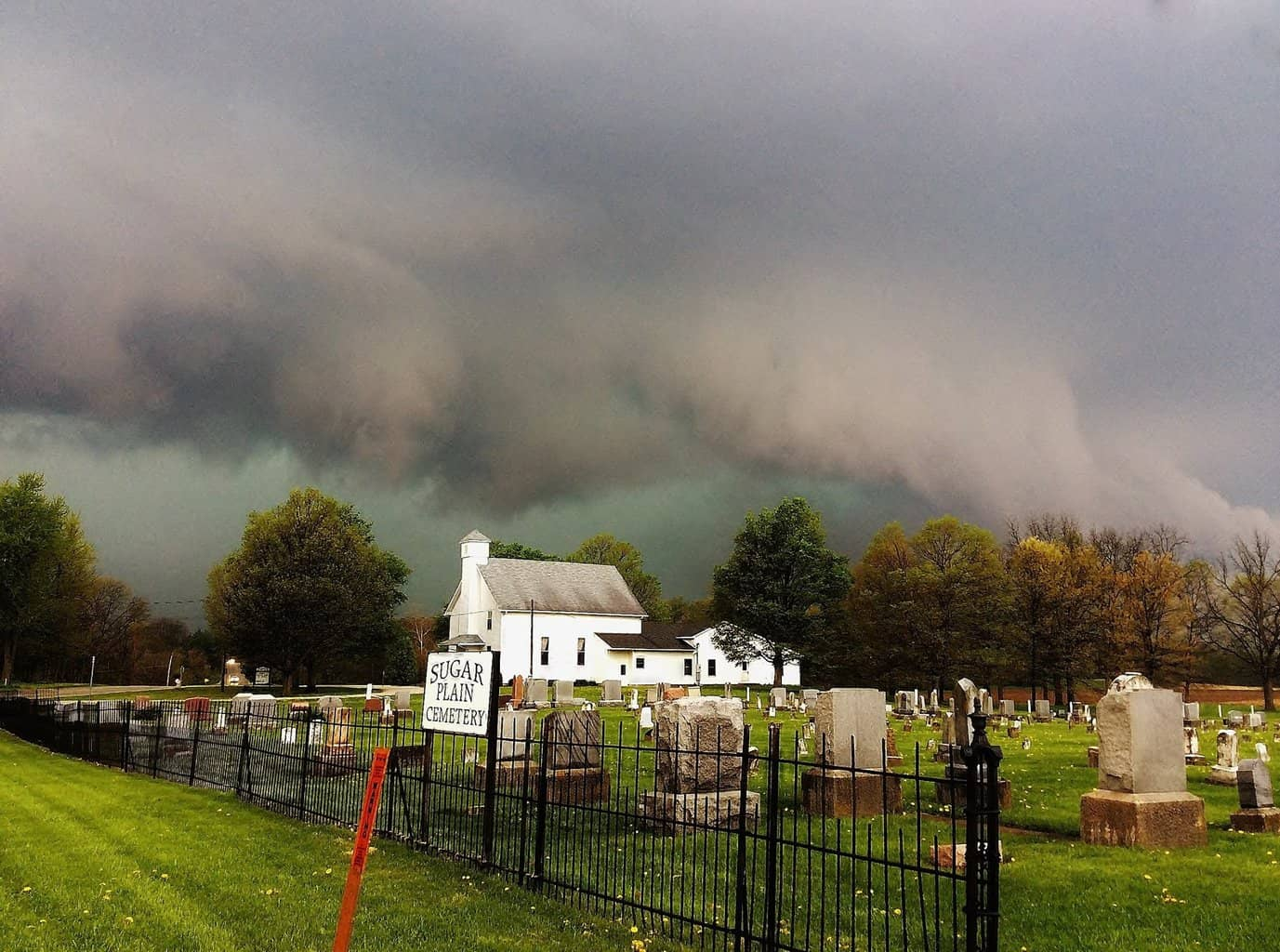 Spring storm over a small-town chapel and cemetery in Indiana. May 2015.