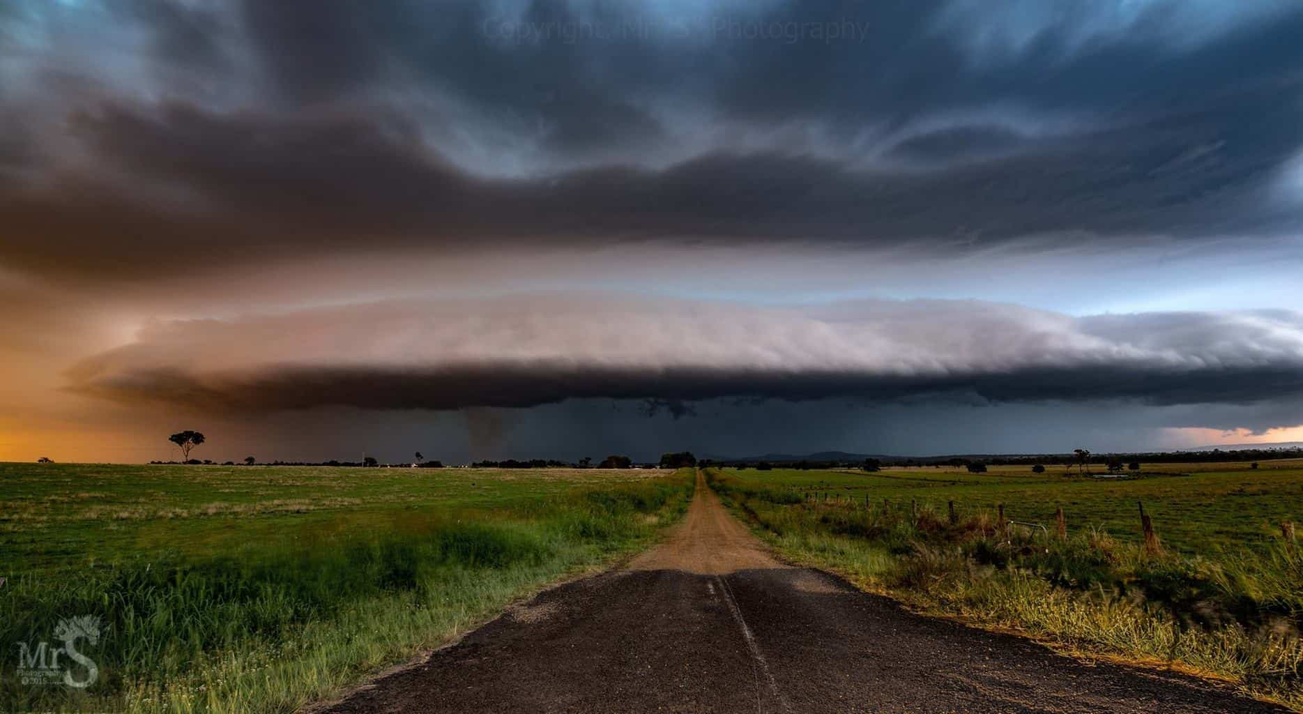 !!! Wrong Turn !!! A beautiful supercell charges along the dirt road straight at me. It had everything. Hail, Amazing winds, Lightning everywhere. And a dustnado to the left of road after allot of checking. Was the ultimate day for me. 23rd Nov 2015 facing Mt Walker West Qld Australia.