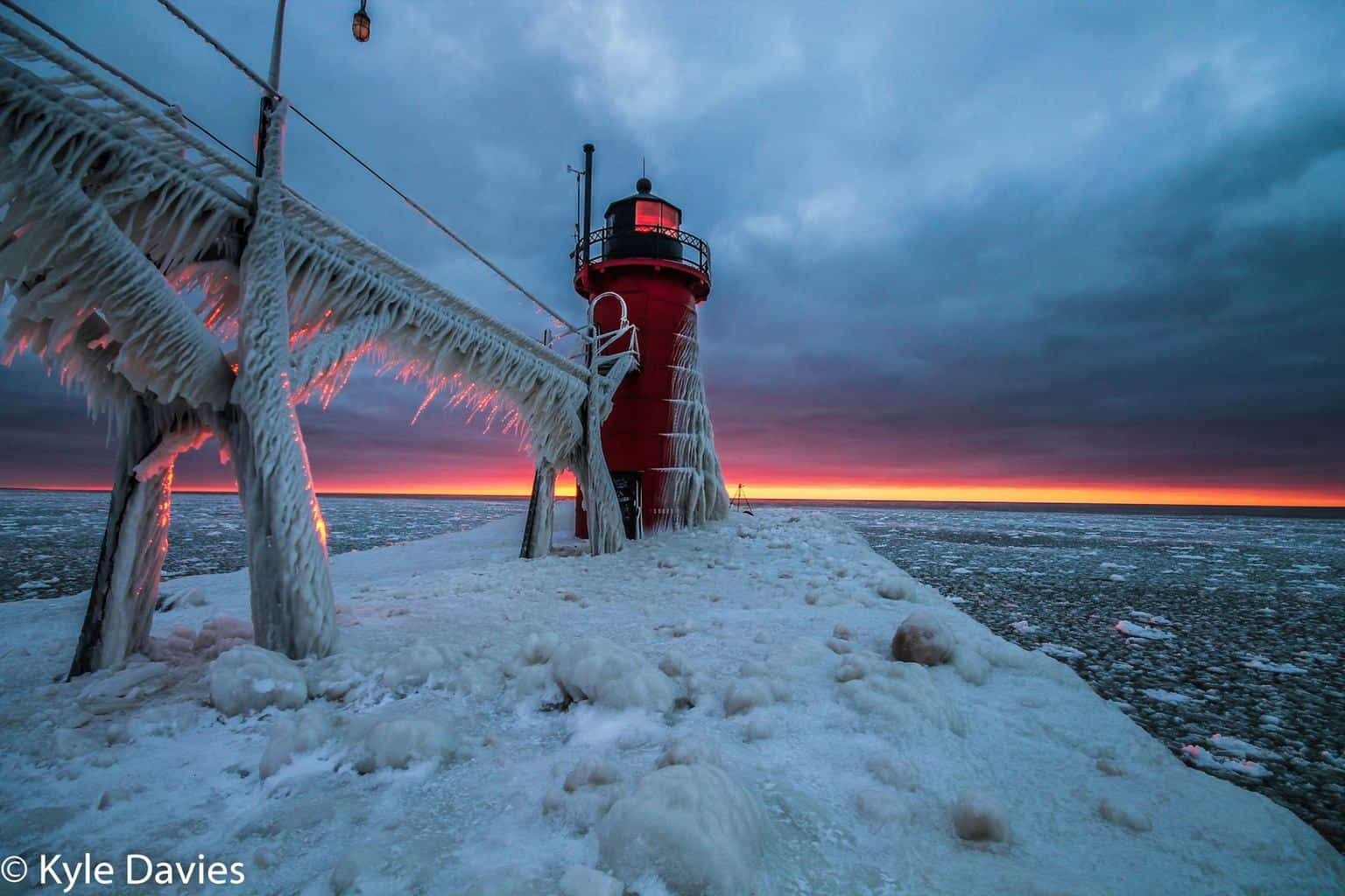 As we are getting closer and closer to old man winter, here is a shot of the South Haven, MI lighthouse encased in ice after a windy winter storm came through.