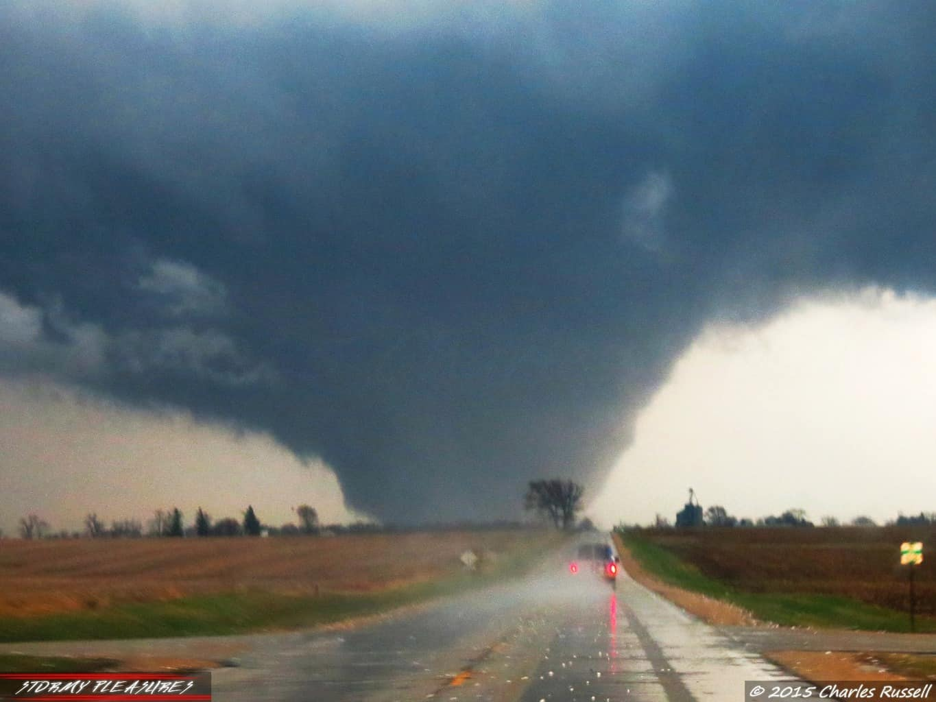 Racing toward the Rochelle, IL EF-4 Wedge Tornado on 4/9/15. Ahead of us, an Extreme Tornado Tours team van shows their guests the tornado of a lifetime. Large hailstones lay all over the road as we blasted toward this tornado. This is a shot that I have never posted before on social media. It was tough to get clear shots of this tornado due to many factors, but we couldn't stop, we would have fell too far behind. I was chasing with my buddy CJ on this day. A day we will never forget. Such an intense and exciting day. Best chase of the year for me, and so far, the largest, most powerful tornado I've ever documented.