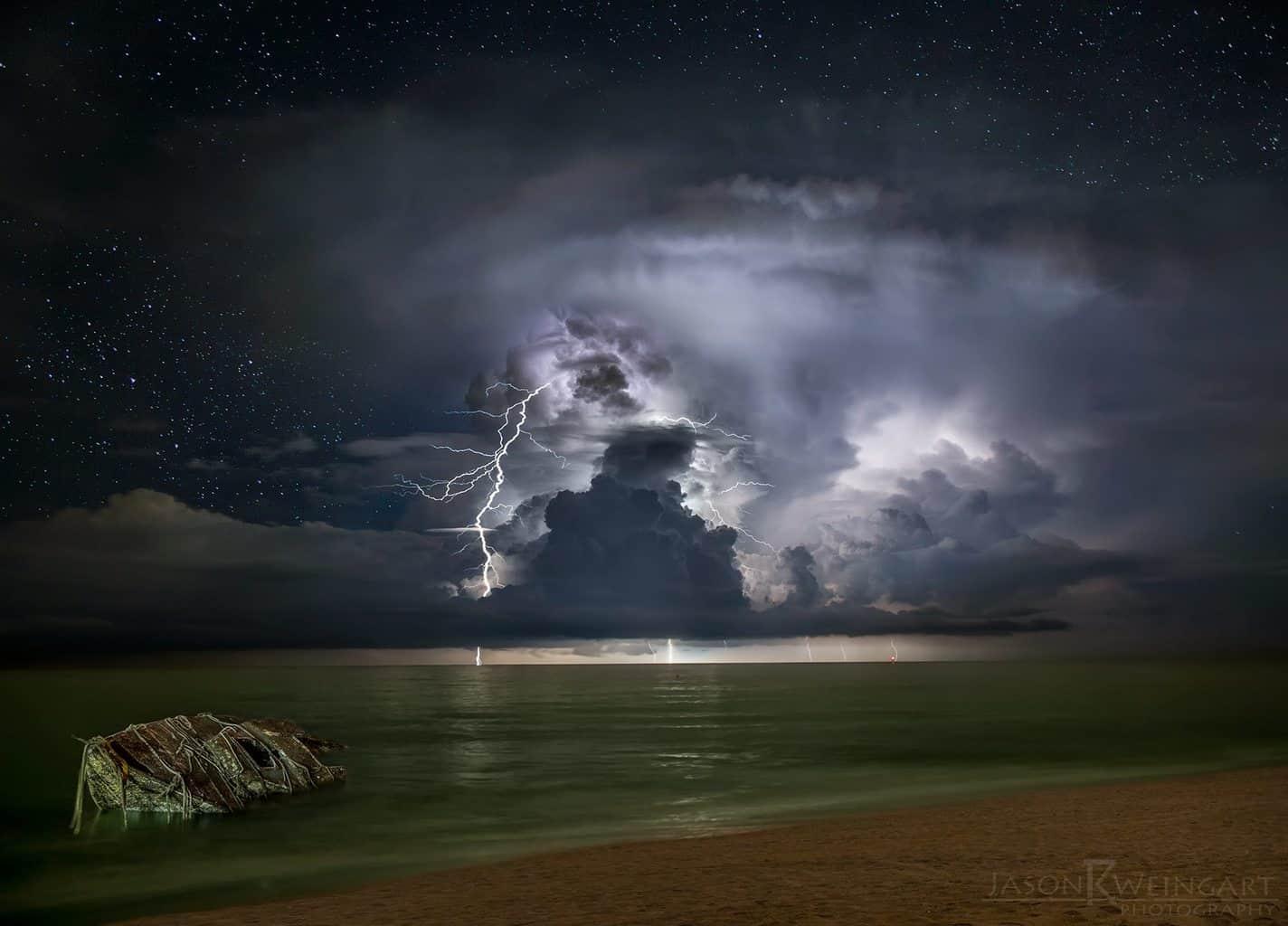 Thunderhead and a sunken boat off the coast of Palm Beach, Florida.