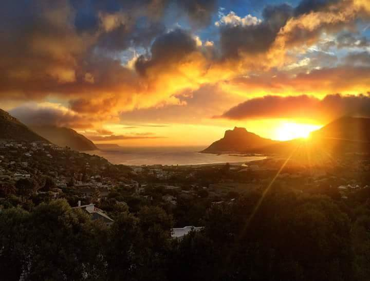 My home. Sunset over Hout Bay, South Africa, Cape Town mountains.