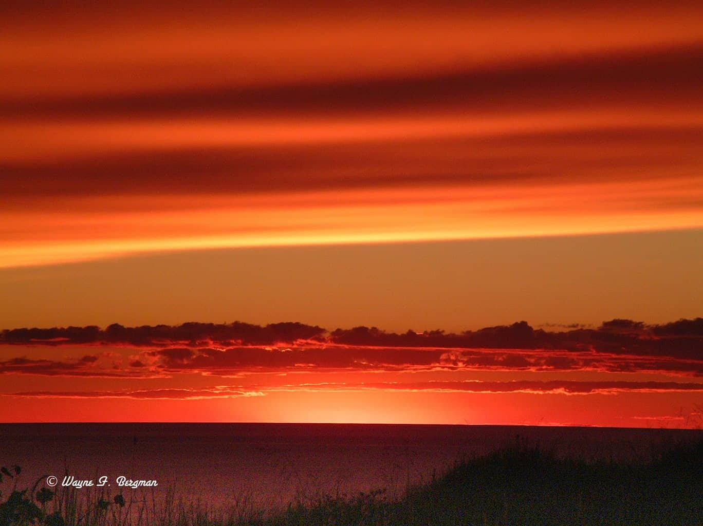 One of the most unusual sunsets over Lake Michigan that I have ever seen, this was during all the fires out west and in Canada that made for a spectacular red Photo, this picture is as is untouched.