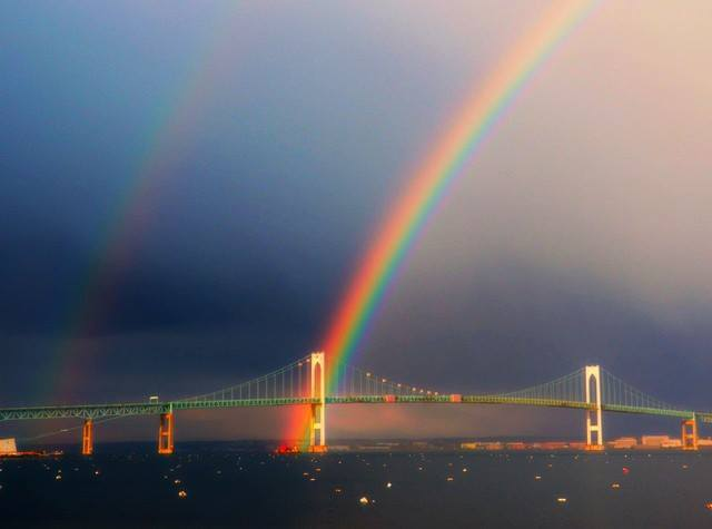 April 11 2012 Intense #rainbow over#NewportBridge over #NarragansettBay, after a day of on and off #showers. — in Jamestown, Rhode Island.