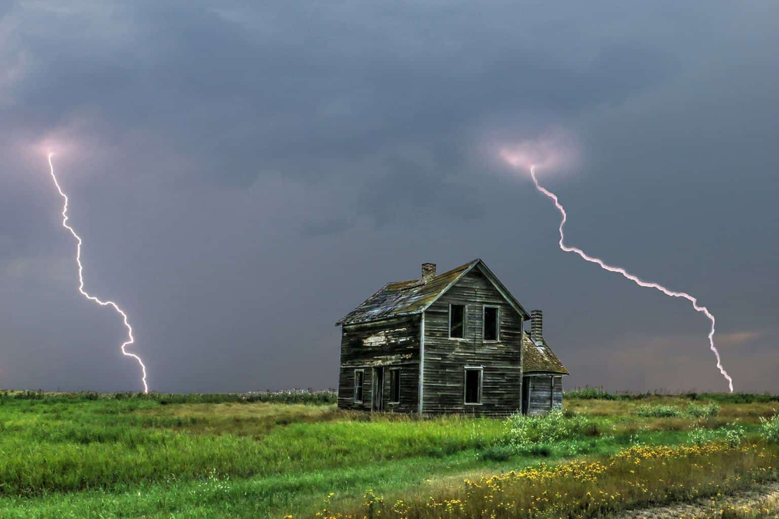 This is one of my favorite lightning photos that I have ever taken. A double bolt that even left the house in the foreground mouth open and wide eyed in awe.
