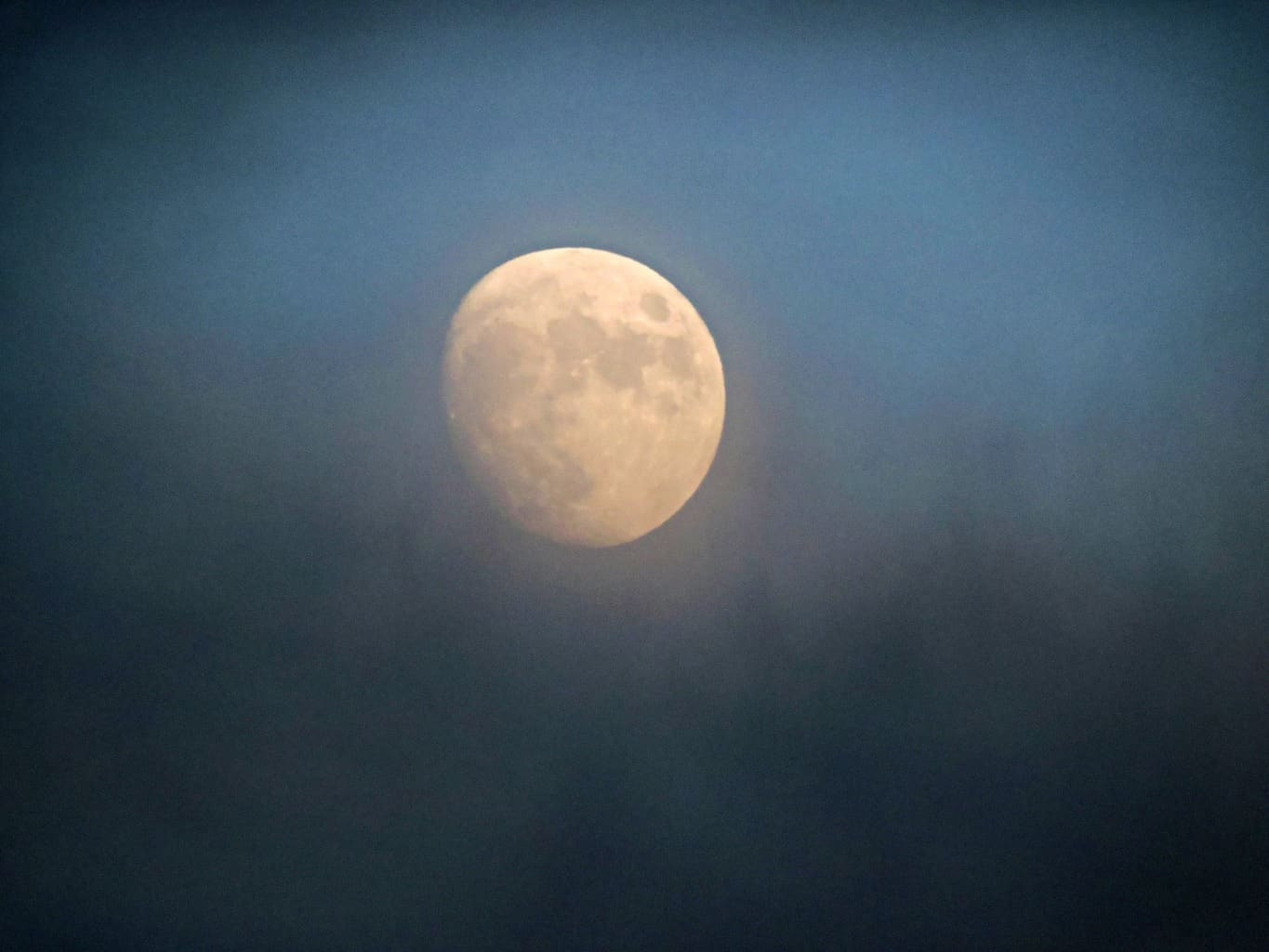 Took this about 10 minutes ago. Clouds moving by just enough to get a nice shot of the moon. Richland, Wa