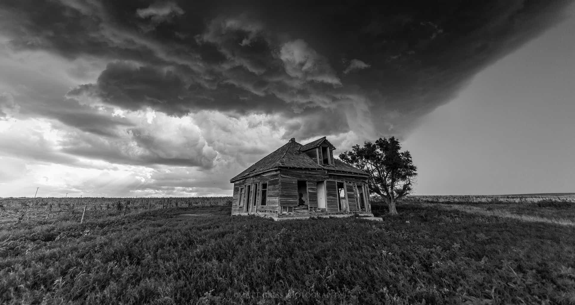 This photo was taken near the McCook, NE area. One of my favorite black and white photos that I have taken. I have always wondered what it would have been like to have lived in rural Nebraska many years ago. Surviving off the land with no electricity, plumbing or any of the necessities that we are so used to having today. Riding out severe weather was probably not as enjoyable as we see it either! July 10th 2015 on a marginal day.