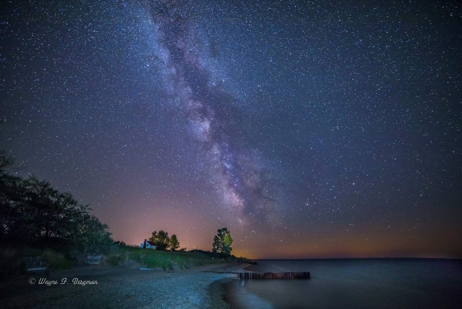 Milky Way on Lake Michigan Shores by Betsie Light House.