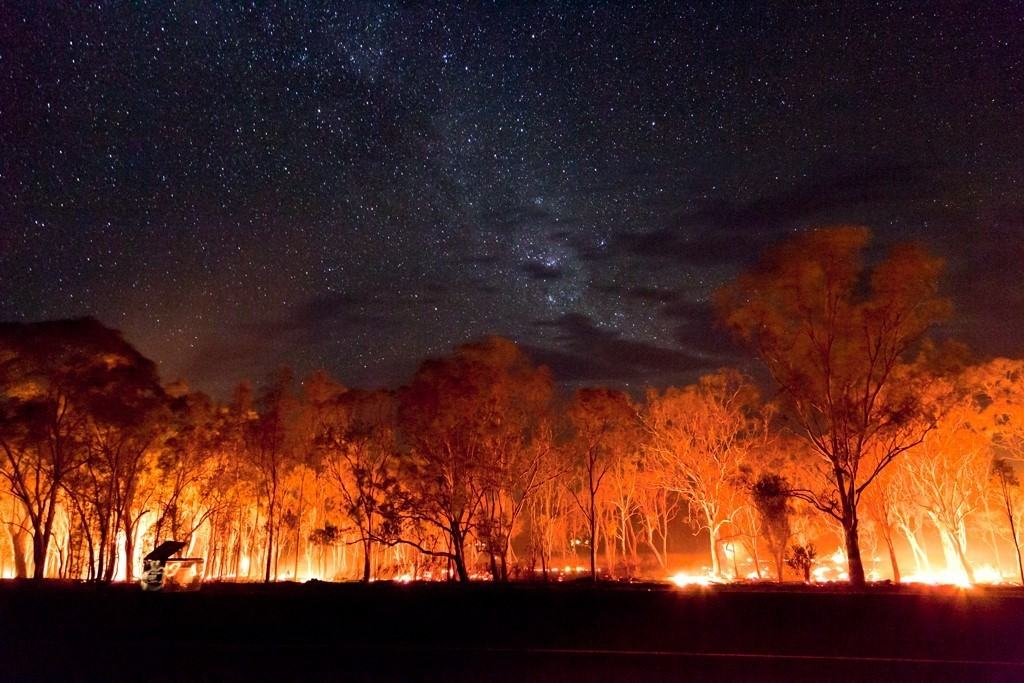 On the way home from an ordinary chase on the 28th of November 2014 I came a across a small grass fire near Inglewood, Queensland, Australia The fire glow and stars together looked amazing.