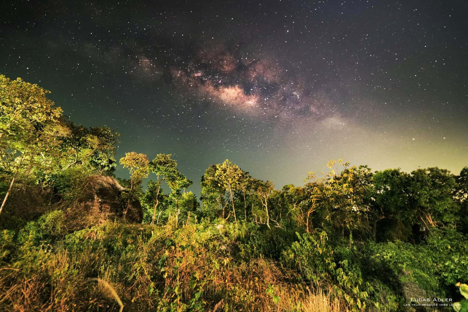 I was shooting a distant monsoon thunderstorm in the Gulf of Thailand when I saw something bright above the jungle...