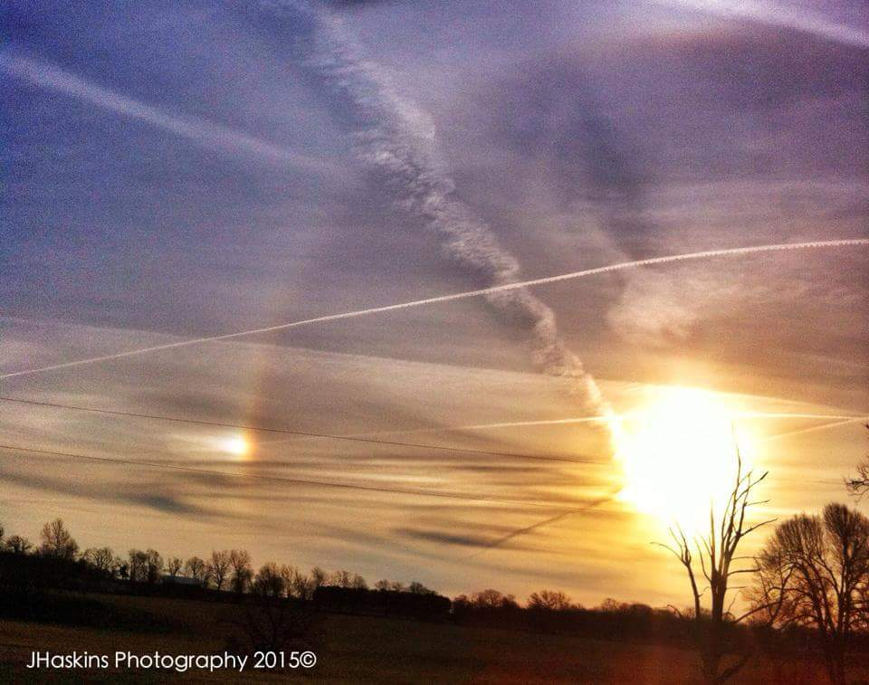 What isn't in this photo. 22° sun halo, a sun dog to the left, cirrus clouds, contrails, all associated with this epic sunset!