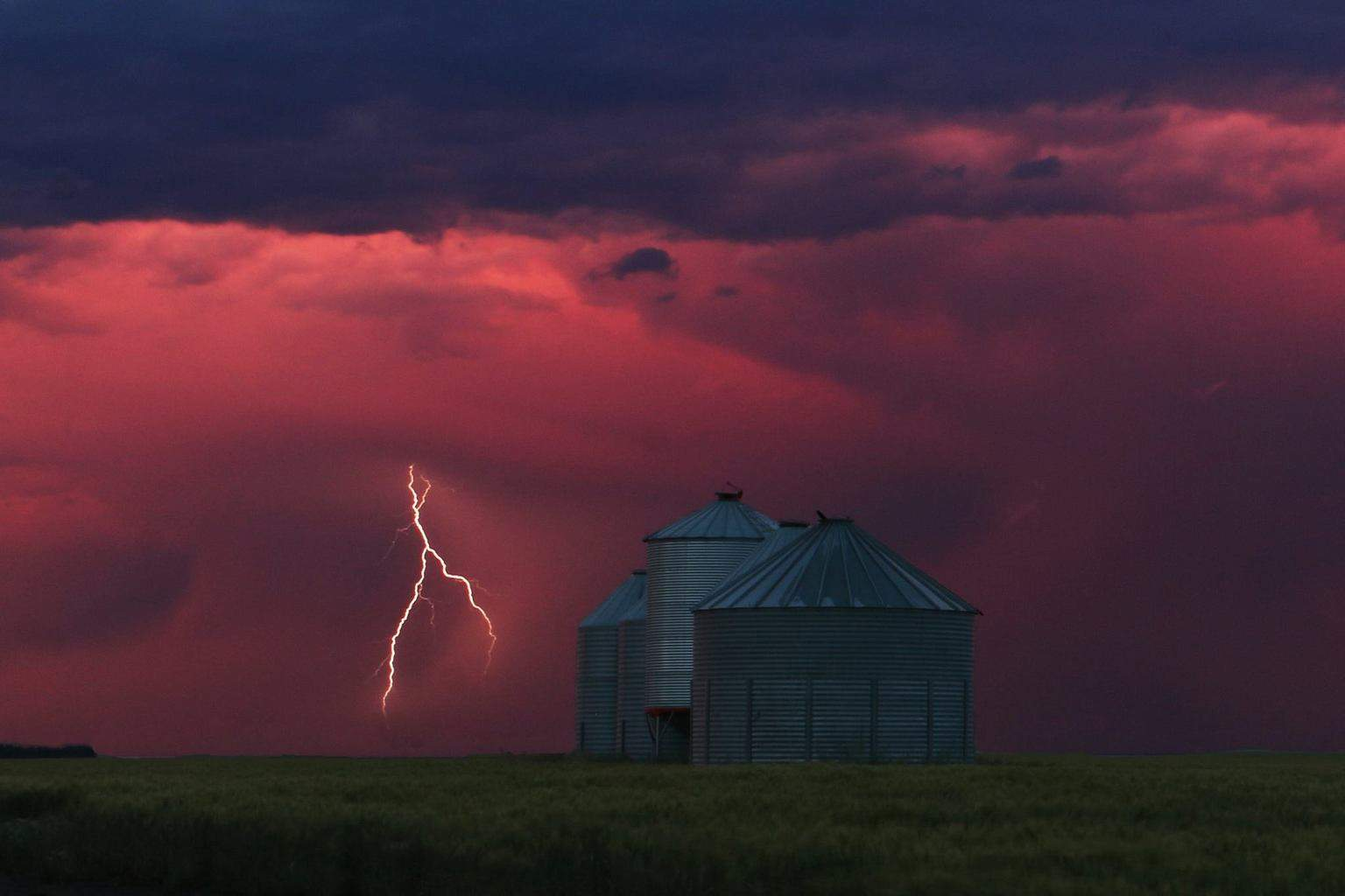 Setting sun set the sky aglow then this bolt of lightning completed this surreal scene. As always I hope you enjoy