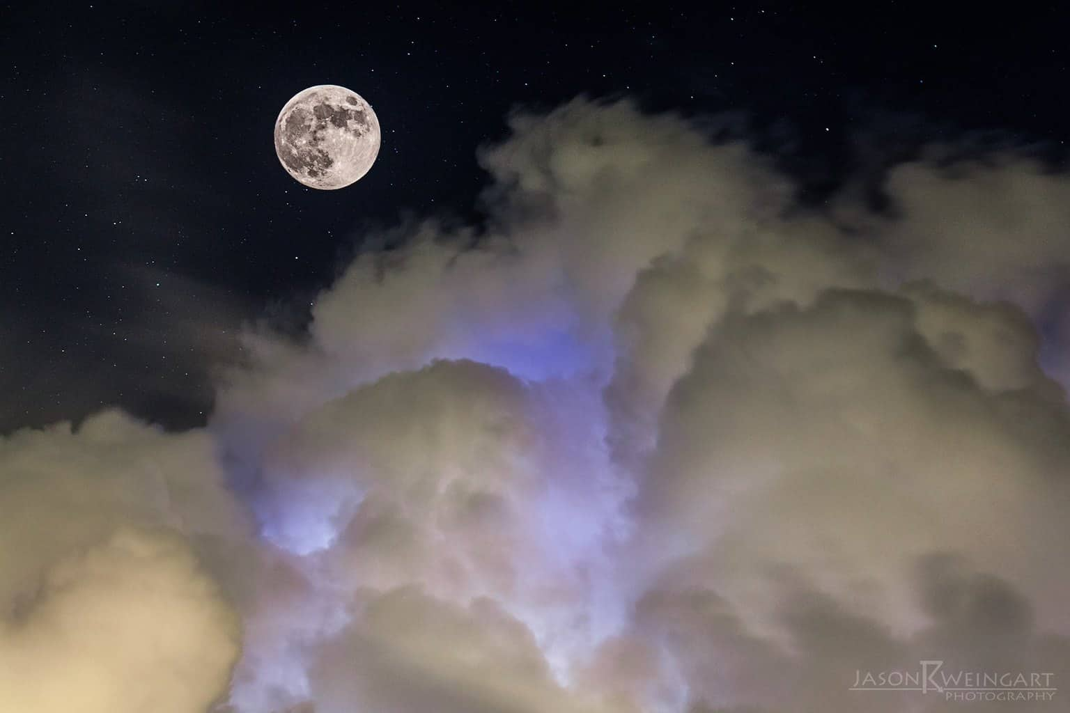 Full moon and intracloud lightning