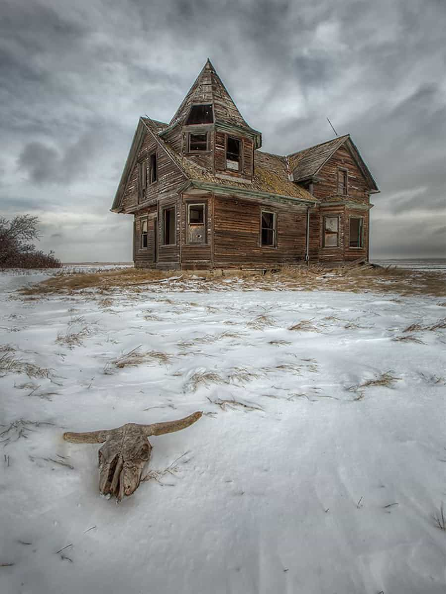 "I drove for 2 hours to get to this old house called ""The Witches House"" in Saskatchewan on Saturday. Within minutes of arriving, the winds picked up to 50 mph. I took 2 quick shots of it through the blowing snow, quickly got back in my truck and headed for home through a February blizzard."