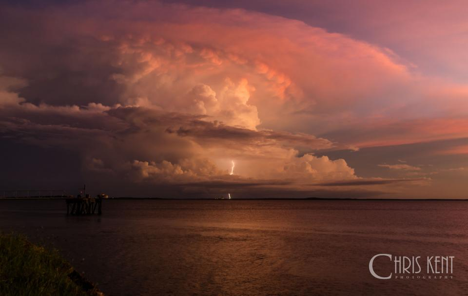 Tropical convection at it's best. Shot from Darwin, Australia, this storm grew explosively over Bachelor, a town about 100km away. Even more surprising was it grew under the anvil of a previous storm right on sunset, providing spectacular colours.