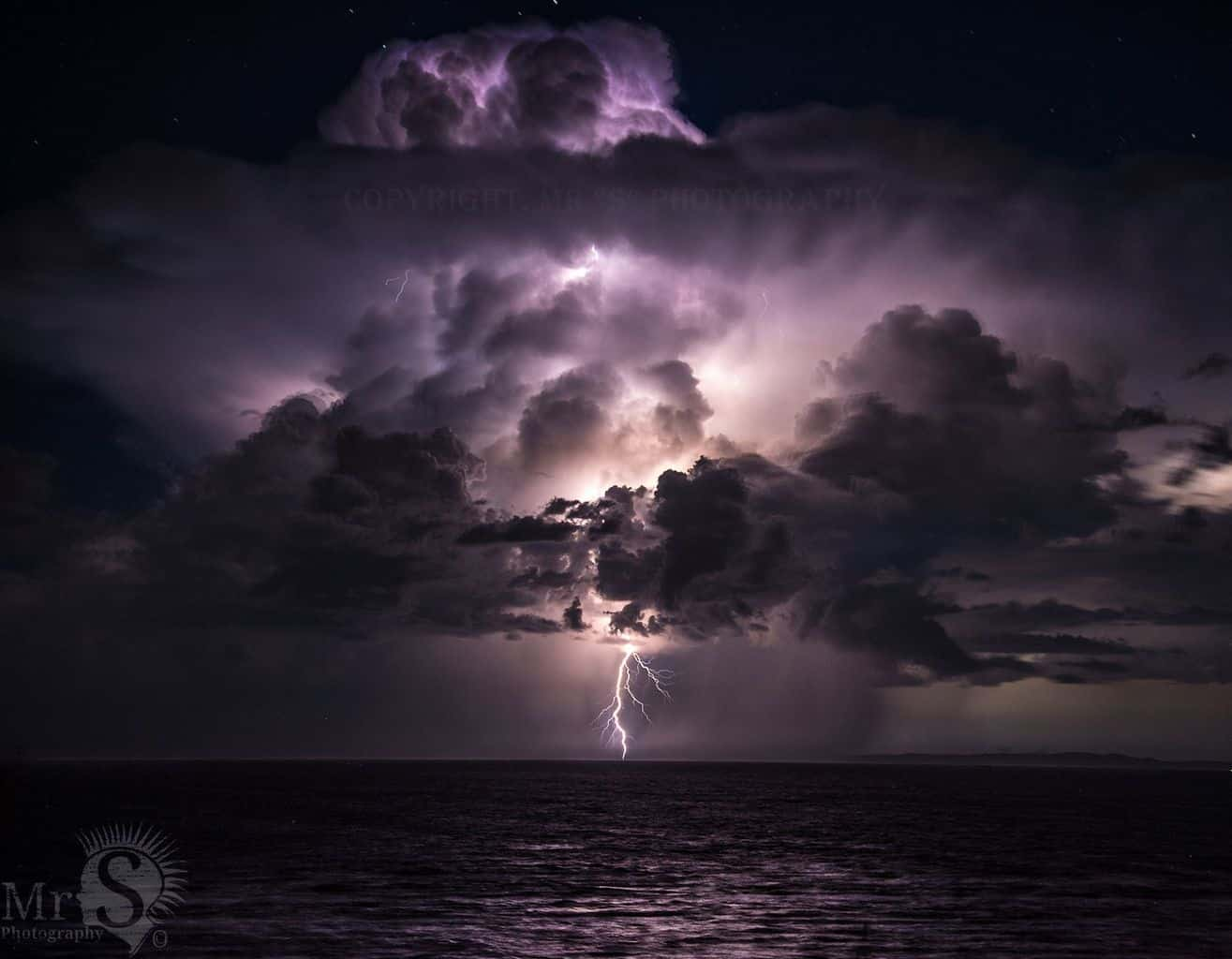 !! A made dash to Shorncliffe !! A shot from one of the 20,000 plus an hour lightning strikes last Monday evening offshore in Qld Australia. I was at Shorncliffe and besides the winds the light show was simply amazing.