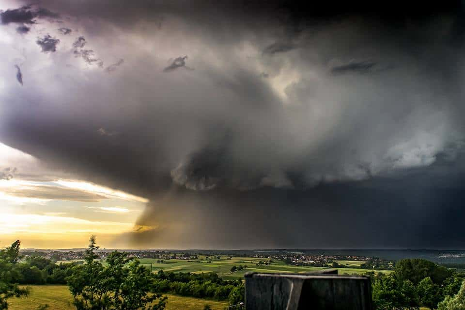 """Nuclear Cloud... Amazing this big wall of heavy rain and Thunderstorm witch appears over the """"Schönbuch"""" near Stuttgart, Germany. Illuminated from the sunset, the sky turned in seconds to black."""